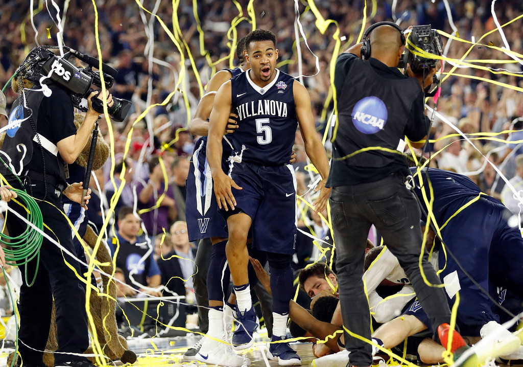 . Villanova\'s Phil Booth (5) celebrates after the NCAA Final Four tournament college basketball championship game against North Carolina, Monday, April 4, 2016, in Houston. Villanova won 77-74. (AP Photo/Eric Gay)