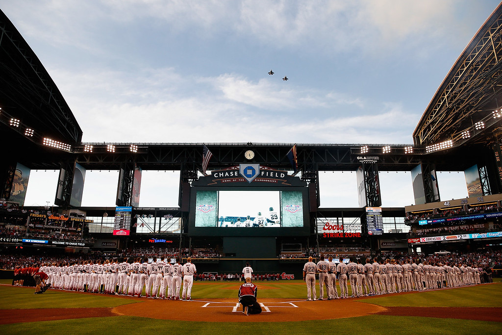 . PHOENIX, AZ - APRIL 04:  General view of the national anthem as the Arizona Diamondbacks and Colorado Rockies stand attended before the MLB opening day game at Chase Field on April 4, 2016 in Phoenix, Arizona.  (Photo by Christian Petersen/Getty Images)