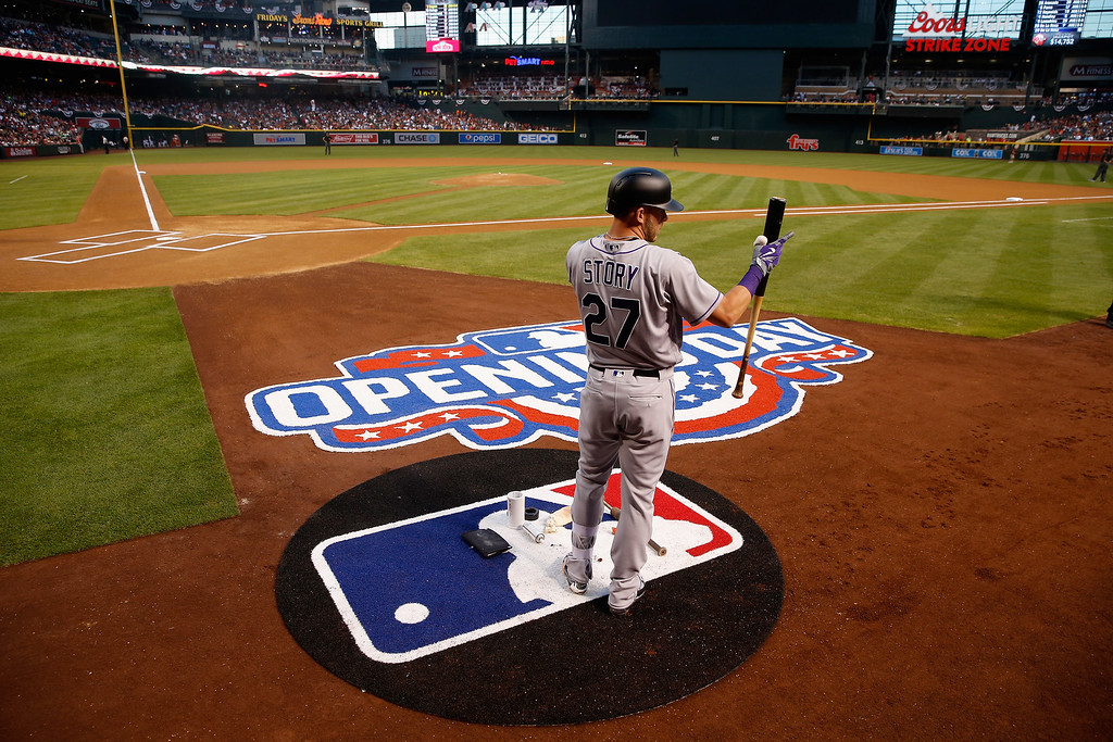 . PHOENIX, AZ - APRIL 04:  Trevor Story #27 of the Colorado Rockies warms up on deck before the start of the MLB opening day game against the Arizona Diamondbacks at Chase Field on April 4, 2016 in Phoenix, Arizona.  (Photo by Christian Petersen/Getty Images)