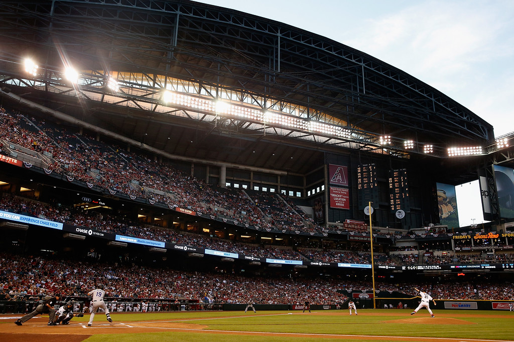 . PHOENIX, AZ - APRIL 04:  Starting pticher Zack Greinke #21 of the Arizona Diamondbacks throws out the first pitch of the MLB opening day game to Charlie Blackmon #19 of the Colorado Rockies at Chase Field on April 4, 2016 in Phoenix, Arizona.  (Photo by Christian Petersen/Getty Images)