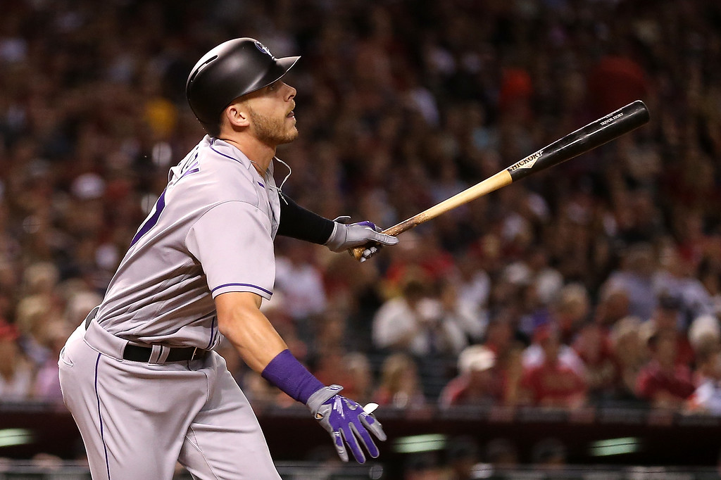 . PHOENIX, AZ - APRIL 04:  Trevor Story #27 of the Colorado Rockies watches his three run home-run against the Arizona Diamondbacks hit during the thrid inning of the MLB opening day game at Chase Field on April 4, 2016 in Phoenix, Arizona.  (Photo by Christian Petersen/Getty Images)