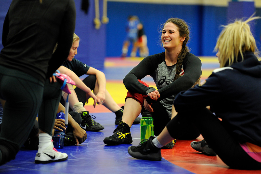 . COLORADO SPRINGS, CO - MARCH 31: United States Olympic hopeful Adeline Gray (center) jokes with teammates during practice on Thursday, March 31, 2016. Gray, who is a three-time world champion, is a favorite to become the United States\' first ever female Olympic wrestling champion. (Photo by AAron Ontiveroz/The Denver Post)