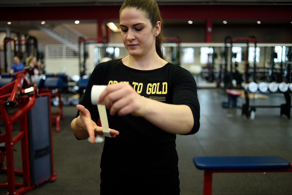 . COLORADO SPRINGS, CO - MARCH 31: United States Olympic hopeful Adeline Gray tapes up during an afternoon workout on Thursday, March 31, 2016. Gray, who is a three-time world champion, is a favorite to become the United States\' first ever female Olympic wrestling champion. (Photo by AAron Ontiveroz/The Denver Post)