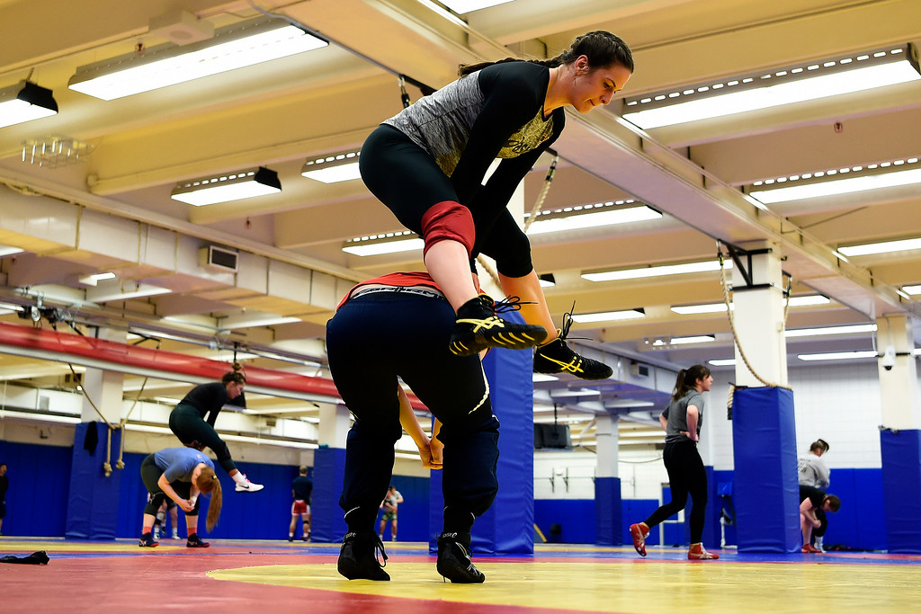 . COLORADO SPRINGS, CO - MARCH 31: United States Olympic hopeful Adeline Gray leaps over training partner Emma Randall during practice on Thursday, March 31, 2016. Gray, who is a three-time world champion, is a favorite to become the United States\' first ever female Olympic wrestling champion. (Photo by AAron Ontiveroz/The Denver Post)