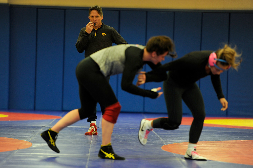 . COLORADO SPRINGS, CO - MARCH 31: Head coach Terry Steiner watches as United States Olympic hopefuls Adeline Gray (left) and Alli Ragan wrestle during practice on Thursday, March 31, 2016. Gray, who is a three-time world champion, is a favorite to become the United States\' first ever female Olympic wrestling champion. (Photo by AAron Ontiveroz/The Denver Post)