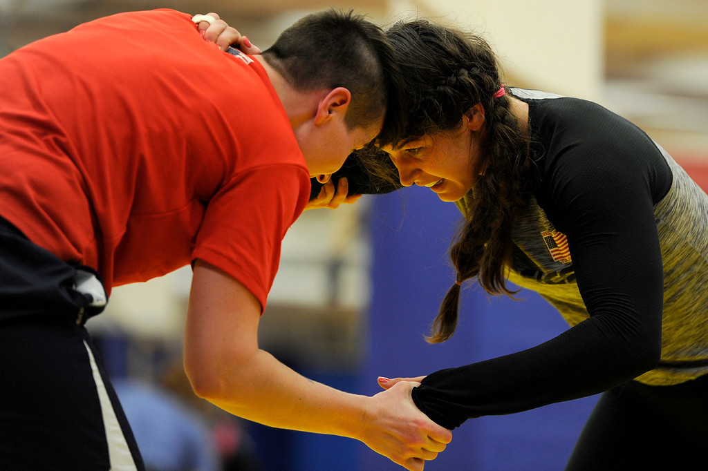 . COLORADO SPRINGS, CO - MARCH 31: United States Olympic hopeful Adeline Gray works for position against training partner Emma Randall during practice on Thursday, March 31, 2016. Gray, who is a three-time world champion, is a favorite to become the United States\' first ever female Olympic wrestling champion. (Photo by AAron Ontiveroz/The Denver Post)