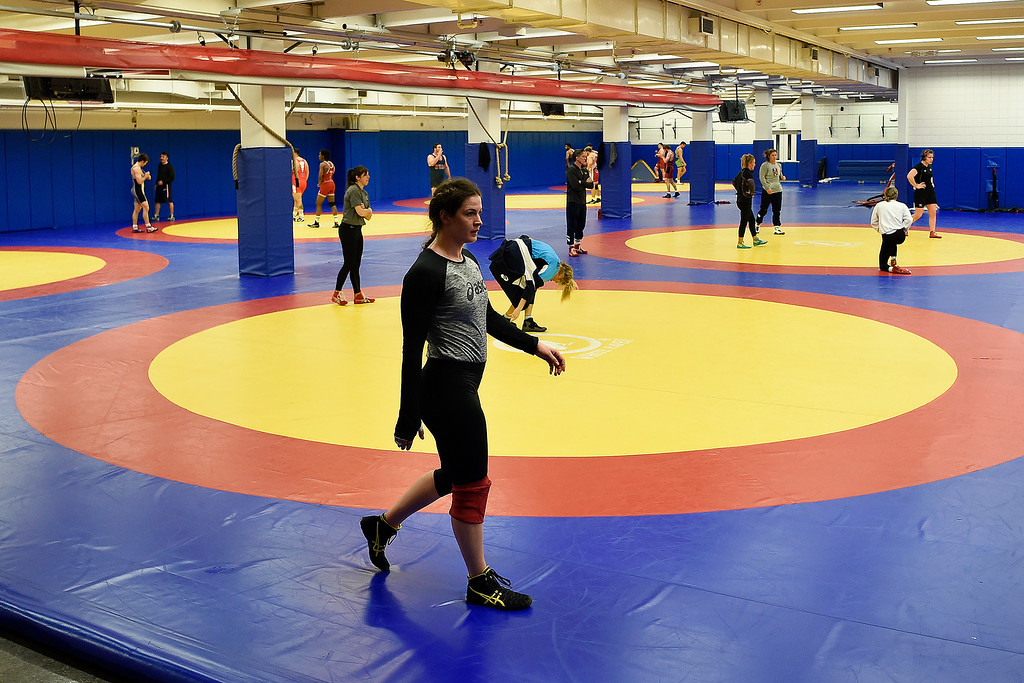 . COLORADO SPRINGS, CO - MARCH 31: United States Olympic hopeful Adeline Gray walks across the mat during practice on Thursday, March 31, 2016. Gray, who is a three-time world champion, is a favorite to become the United States\' first ever female Olympic wrestling champion. (Photo by AAron Ontiveroz/The Denver Post)