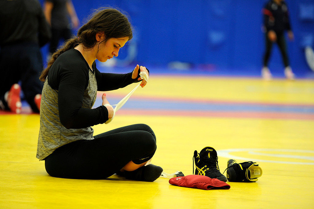 . COLORADO SPRINGS, CO - MARCH 31: United States Olympic hopeful Adeline Gray un tapes her hands after practice on Thursday, March 31, 2016. Gray, who is a three-time world champion, is a favorite to become the United States\' first ever female Olympic wrestling champion. (Photo by AAron Ontiveroz/The Denver Post)