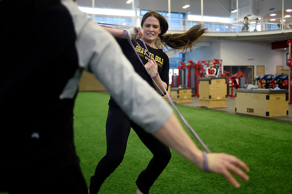 . COLORADO SPRINGS, CO - MARCH 31: United States Olympic hopeful Adeline Gray works on hand fighting with bands attached to her wrists and those of strength coach Paul Titus during an afternoon workout on Thursday, March 31, 2016. Gray, who is a three-time world champion, is a favorite to become the United States\' first ever female Olympic wrestling champion. (Photo by AAron Ontiveroz/The Denver Post)