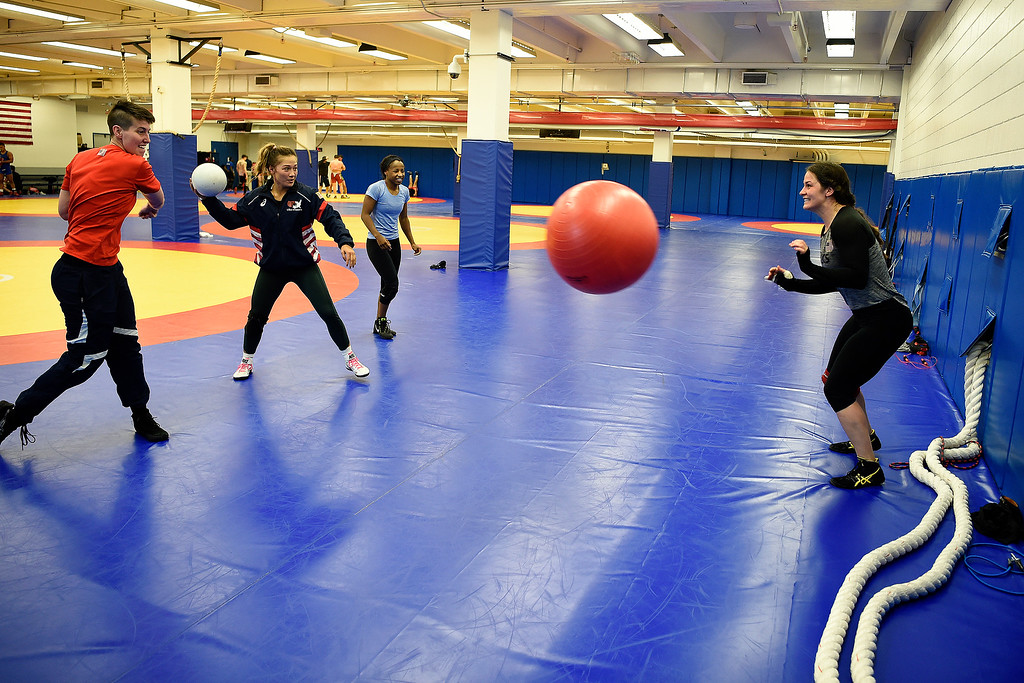 . COLORADO SPRINGS, CO - MARCH 31: United States Olympic hopeful Adeline Gray (right) dodges balls thrown by (from left) training partner Emma Randall, Alli Ragan and Erin Golston during practice on Thursday, March 31, 2016. Gray, who is a three-time world champion, is a favorite to become the United States\' first ever female Olympic wrestling champion. (Photo by AAron Ontiveroz/The Denver Post)