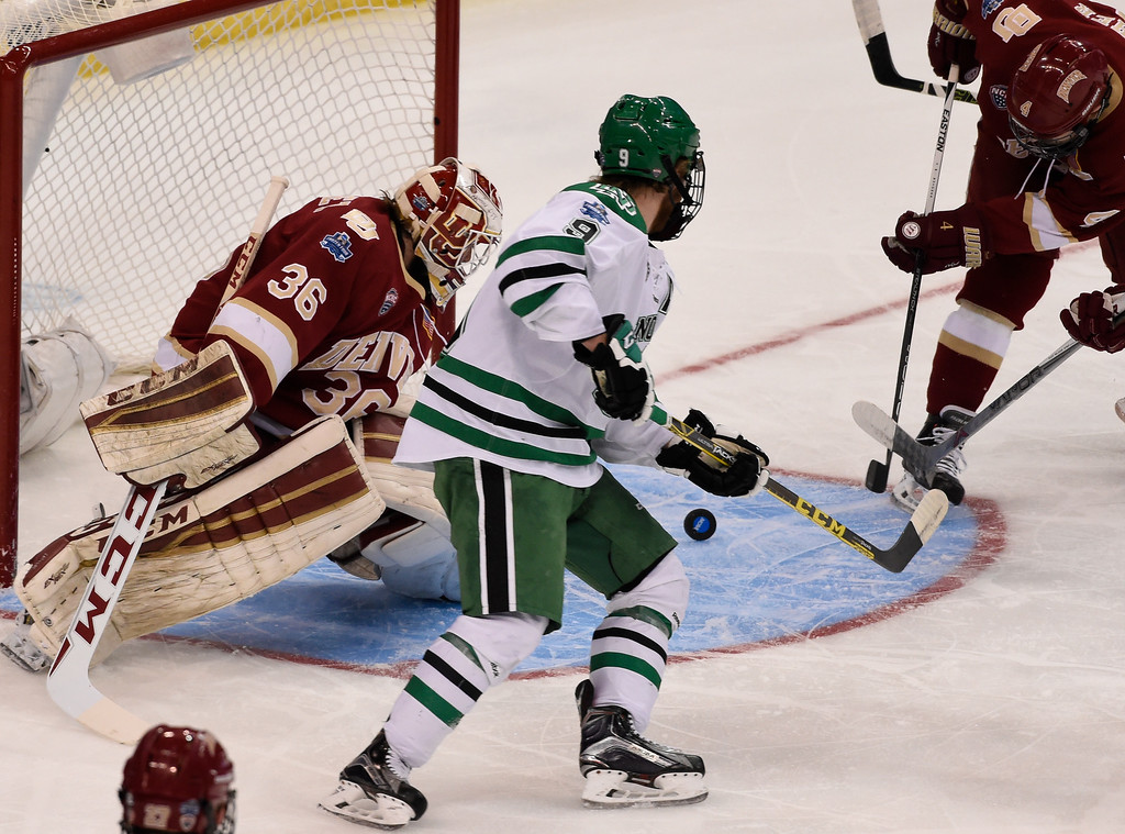 . TAMPA, FL - APRIL 07: Denver Pioneers goalie Tanner Jaillet (36) makes a save on a shot as North Dakota Fighting Hawks forward Drake Caggiula (9) looks on during the first period in the NCAA Tournament - National Semifinals April 7, 2016 at Amalie Arena. (Photo By John Leyba/The Denver Post)