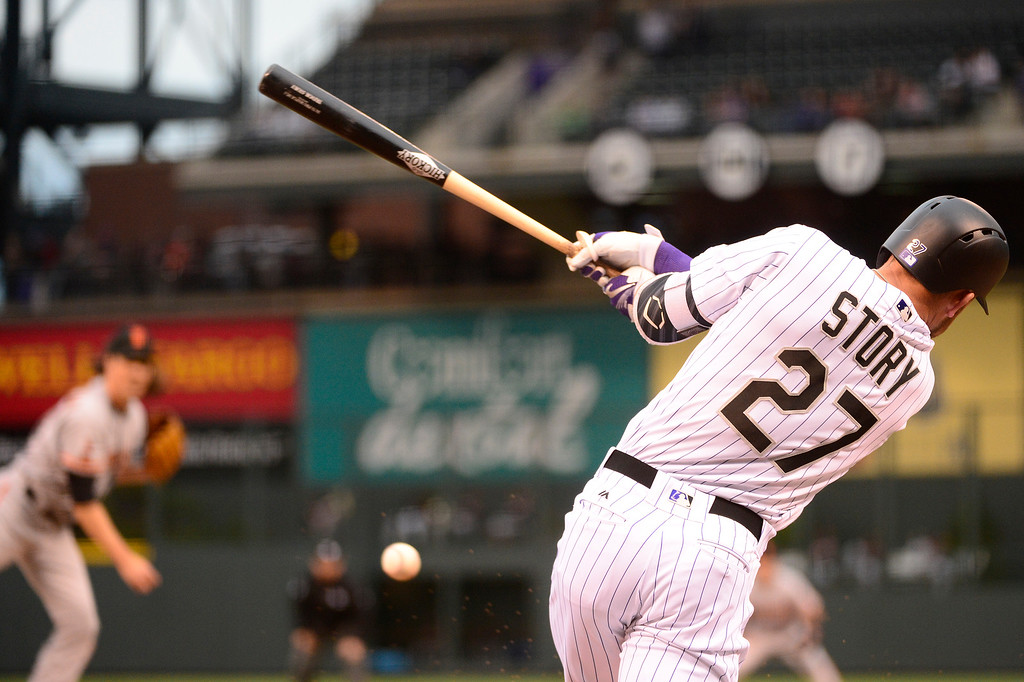. DENVER, CO - APRIL 12: Colorado Rockies shortstop Trevor Story (27) hits a foul ball during the first inning at Coors Field on April 12, 2016 in Denver, Colorado. (Photo by Brent Lewis/The Denver Post)