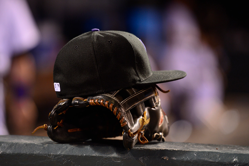 . DENVER, CO - APRIL 12: Colorado Rockies center fielder Charlie Blackmon\'s (19) hat and glove sit in the dugout at Coors Field on April 12, 2016 in Denver, Colorado. San Francisco Giants defeated Colorado Rockies 7-2. (Photo by Brent Lewis/The Denver Post)