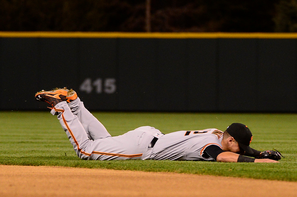. DENVER, CO - APRIL 12: San Francisco Giants second baseman Joe Panik (12) lays on the field after missing a shot to center field during the fifth inning at Coors Field on April 12, 2016 in Denver, Colorado. (Photo by Brent Lewis/The Denver Post)