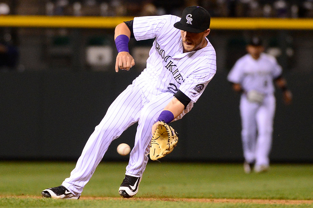 . DENVER, CO - APRIL 12: Colorado Rockies shortstop Trevor Story (27) grabs a shot to center field  at Coors Field on April 12, 2016 in Denver, Colorado. (Photo by Brent Lewis/The Denver Post)