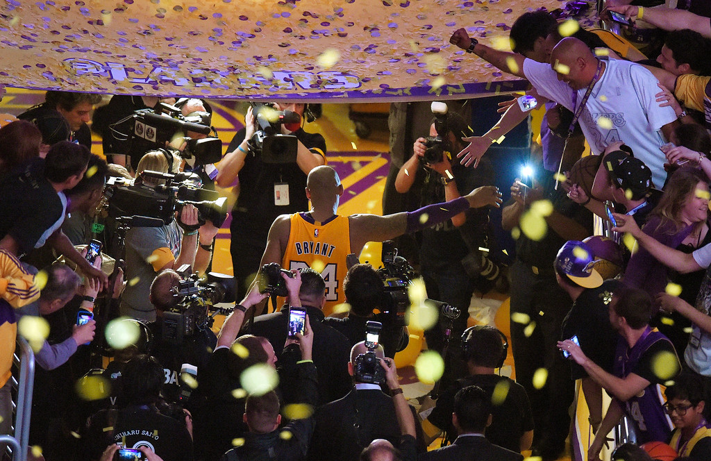 . Los Angeles Lakers forward Kobe Bryant walks off the court after finishing his last NBA basketball game before retirement, against the Utah Jazz on Wednesday, April 13, 2016, in Los Angeles. Bryant scored 60 points as the Lakers won 101-96. (AP Photo/Mark J. Terrill)