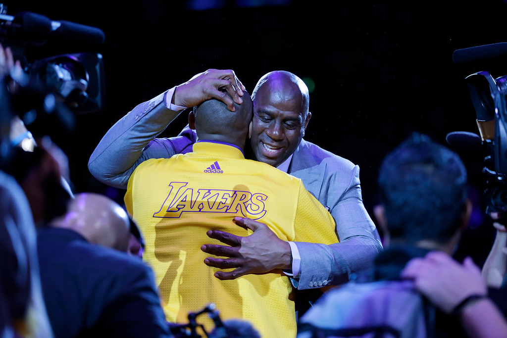 . Los Angeles Lakers forward Kobe Bryant, left, hugs Magic Johnson during a ceremony before Bryant\'s last NBA basketball game, against the Utah Jazz, Wednesday, April 13, 2016, in Los Angeles. (AP Photo/Jae C. Hong)