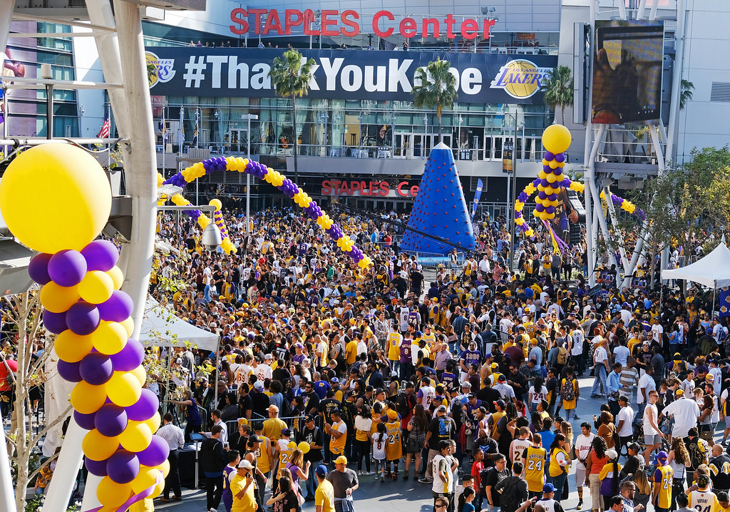 . Fans gather outside Staples Center before Kobe Bryant played his last NBA basketball game, against the Utah Jazz, in downtown Los Angeles on Wednesday, April 13, 2016. (AP Photo/Richard Vogel)