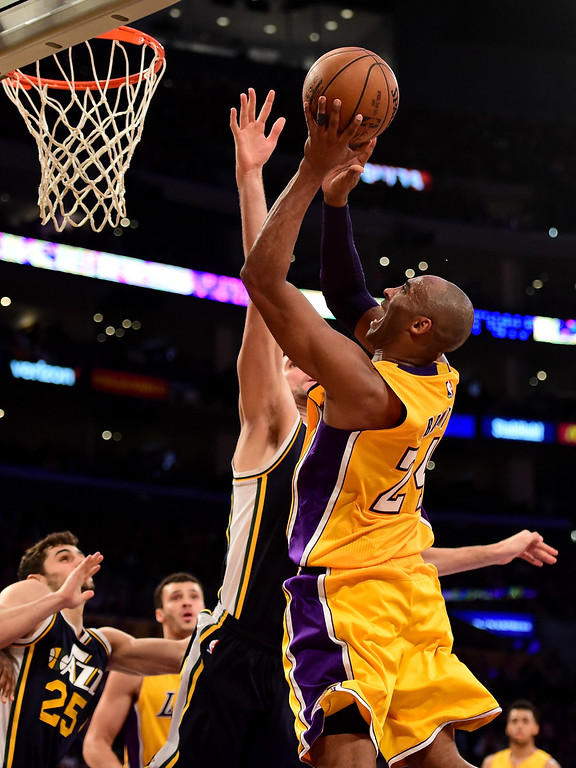. LOS ANGELES, CA - APRIL 13:  Kobe Bryant #24 of the Los Angeles Lakers goes up for a shot against the Utah Jazz in the fourth quarter at Staples Center on April 13, 2016 in Los Angeles, California. NOTE TO USER: User expressly acknowledges and agrees that, by downloading and or using this photograph, User is consenting to the terms and conditions of the Getty Images License Agreement.  (Photo by Harry How/Getty Images)