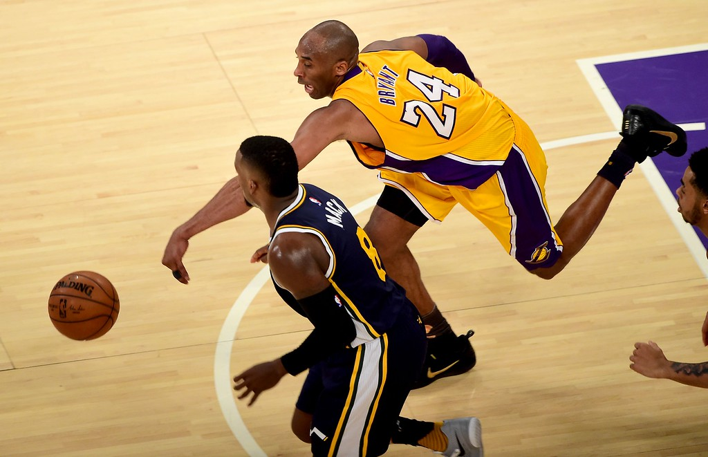 . Kobe Bryant of the Los Angeles Lakers vies for the ball with Shelvin Mack of the Utah Jazz during his final game as a Laker in their season-ending NBA western division matchup aainst the Utah Jazz in Los Angeles, California on April 13, 2016. / AFP PHOTO / FREDERIC J. BROWNFREDERIC J. BROWN/AFP/Getty Images