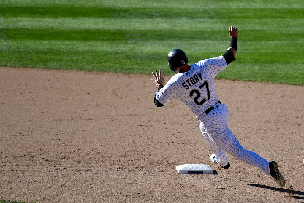 . DENVER, CO - APRIL 24: Colorado Rockies shortstop Trevor Story (27) rounds second base in the 8th inning and scores on a Colorado Rockies right fielder Carlos Gonzalez (5) single to right field against the Los Angeles Dodgers April 24, 2016 at Coors Field. (Photo By John Leyba/The Denver Post)