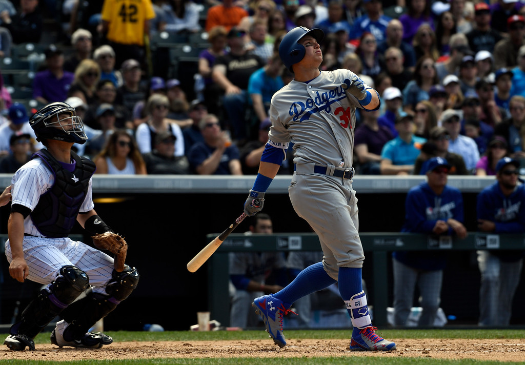 . DENVER, CO - APRIL 24: Los Angeles Dodgers center fielder Joc Pederson (31) watches as he hits a homer to right field against the Colorado Rockies in the third April 24, 2016 at Coors Field. (Photo By John Leyba/The Denver Post)