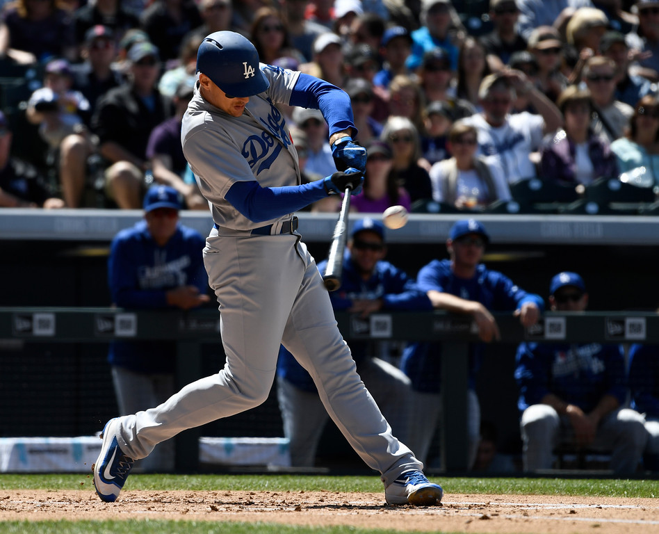 . DENVER, CO - APRIL 24: Los Angeles Dodgers center fielder Trayce Thompson (21) hits a double to right field against the Colorado Rockies in the second inning April 24, 2016 jet Coors Field. (Photo By John Leyba/The Denver Post)