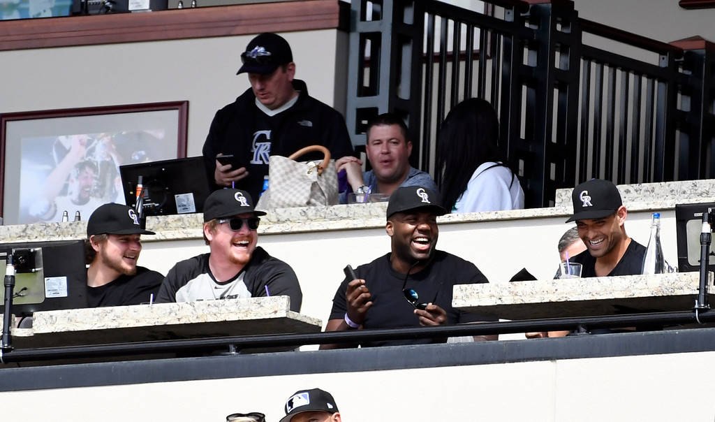 . DENVER, CO - APRIL 24: Left to right  Offensive linemen Ty Sambrailo, Matt Paradis, Russell Okung and  Mark Sanchez take in the Colorado Rockies vs Los Angeles Dodgers game April 24, 2016 at Coors Field. (Photo By John Leyba/The Denver Post)