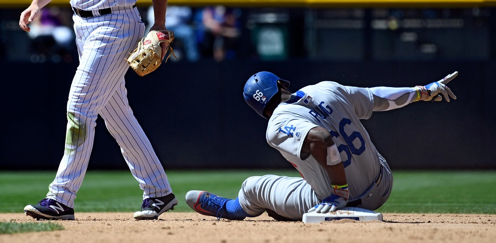 . DENVER, CO - APRIL 24: Los Angeles Dodgers right fielder Yasiel Puig (66) calls for time as he sits not he base after hitting a double in the second inning against the Colorado Rockies April 24, 2016 at Coors Field. (Photo By John Leyba/The Denver Post)
