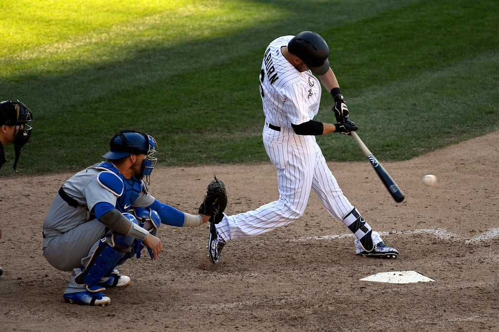 . DENVER, CO - APRIL 24: ,Colorado Rockies left fielder Ryan Raburn (6) hits a single to score Colorado Rockies catcher Dustin Garneau (13) in the 8th inning against the Los Angeles Dodgers April 24, 2016 at Coors Field. (Photo By John Leyba/The Denver Post)