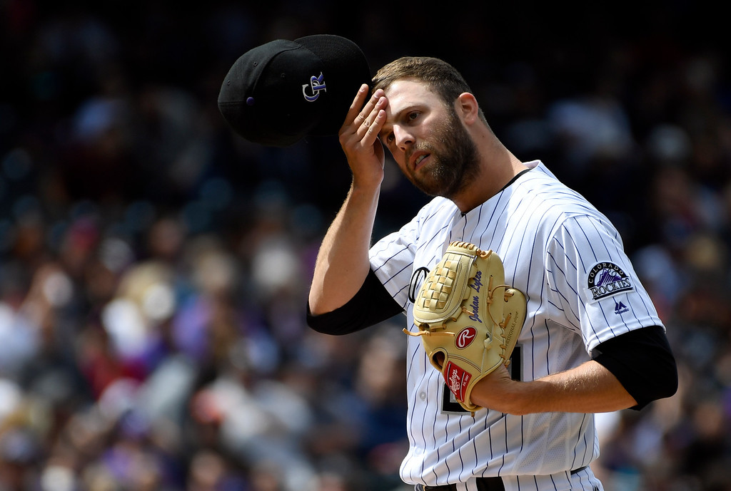 . DENVER, CO - APRIL 24: Colorado Rockies starting pitcher Jordan Lyles (24) wipes his forehead between pitches against the Los Angeles Dodgers in the first inning April 24, 2016 jet Coors Field. (Photo By John Leyba/The Denver Post)