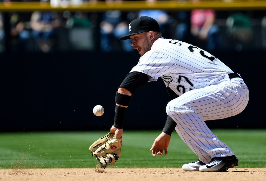 . DENVER, CO - APRIL 24: Colorado Rockies shortstop Trevor Story (27) can\'t handle a hard grounder by Los Angeles Dodgers starting pitcher Alex Wood (57) during the second inning April 24, 2016 at Coors Field. Los Angeles Dodgers center fielder Joc Pederson (31) scored on the play. (Photo By John Leyba/The Denver Post)