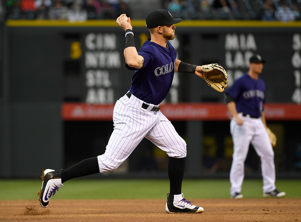 . DENVER, CO - APRIL 25: Trevor Story (27) of the Colorado Rockies throws out Francisco Cervelli (29) of the Pittsburgh Pirates to end the first inning during their game at Coors Field. The Colorado Rockies hosted the Pittsburgh Pirates on Monday, April 25, 2016. (Photo by AAron Ontiveroz/The Denver Post)