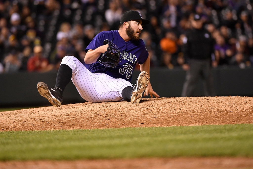 . DENVER, CO - APRIL 25: Chad Bettis (35) of the Colorado Rockies sits in the dirt after stopping a ball hit by Starling Marte (6) of the Pittsburgh Pirates during the fifth inning at Coors Field. The Colorado Rockies hosted the Pittsburgh Pirates on Monday, April 25, 2016. (Photo by AAron Ontiveroz/The Denver Post)