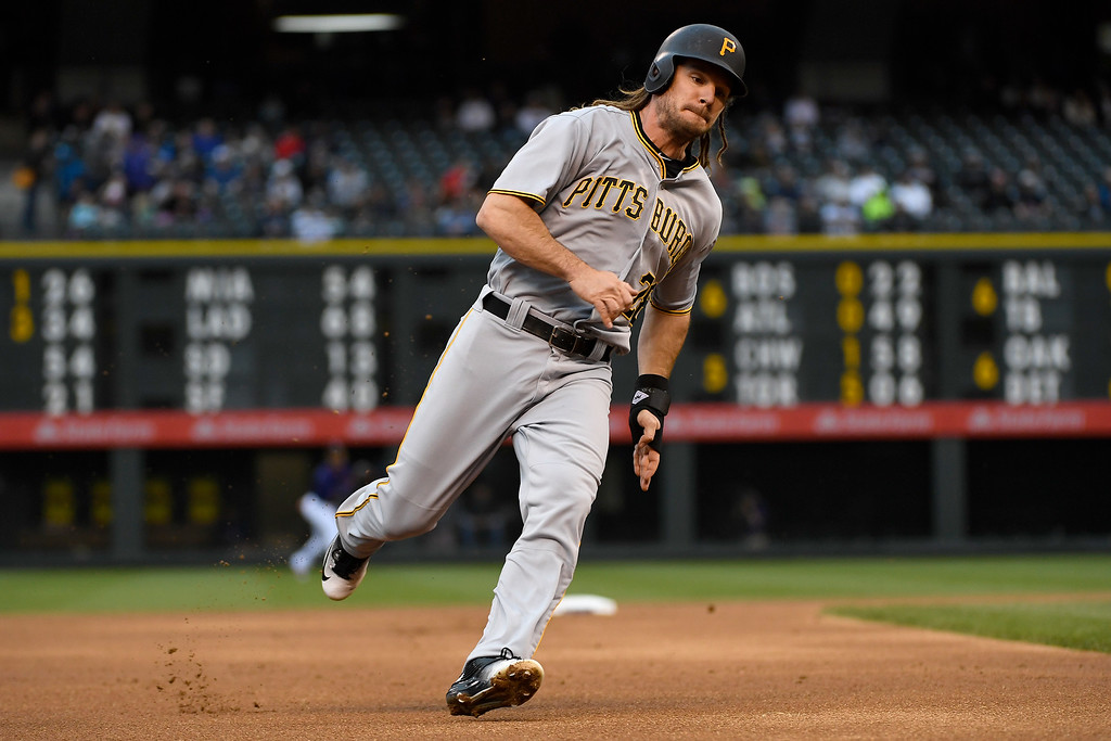 . DENVER, CO - APRIL 25: John Jaso (28) of the Pittsburgh Pirates looks to round third, but holds up on a hit by Starling Marte (6) during the first inning at Coors Field. The Colorado Rockies hosted the Pittsburgh Pirates on Monday, April 25, 2016. (Photo by AAron Ontiveroz/The Denver Post)