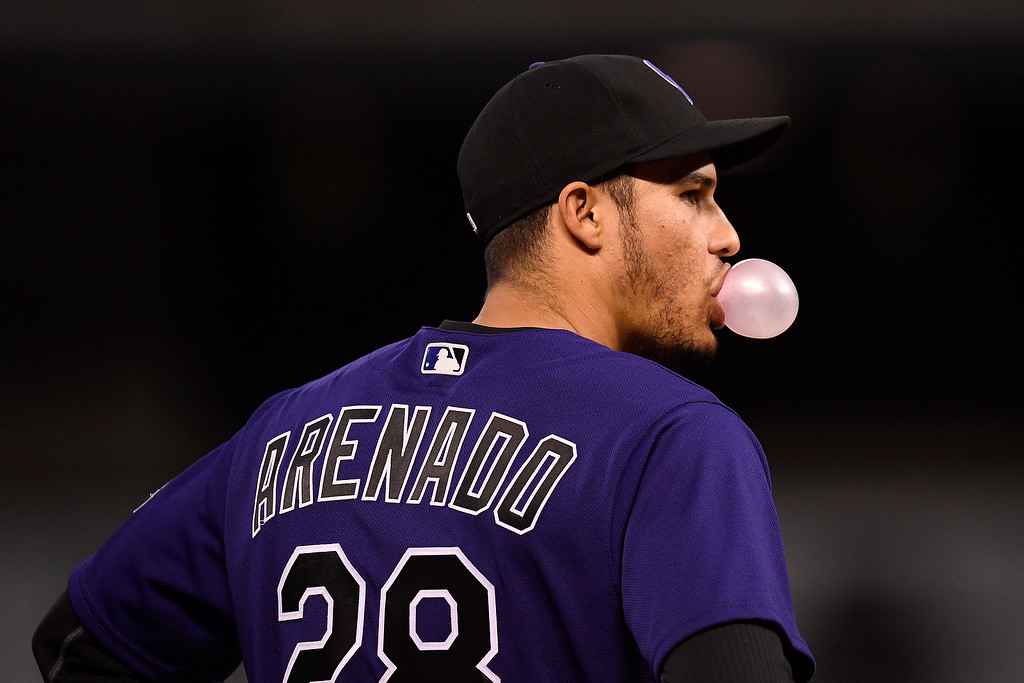 . DENVER, CO - APRIL 25: Nolan Arenado (28) of the Colorado Rockies blows a bubble during a break in the second inning against the Pittsburgh Pirates at Coors Field. The Colorado Rockies hosted the Pittsburgh Pirates on Monday, April 25, 2016. (Photo by AAron Ontiveroz/The Denver Post)