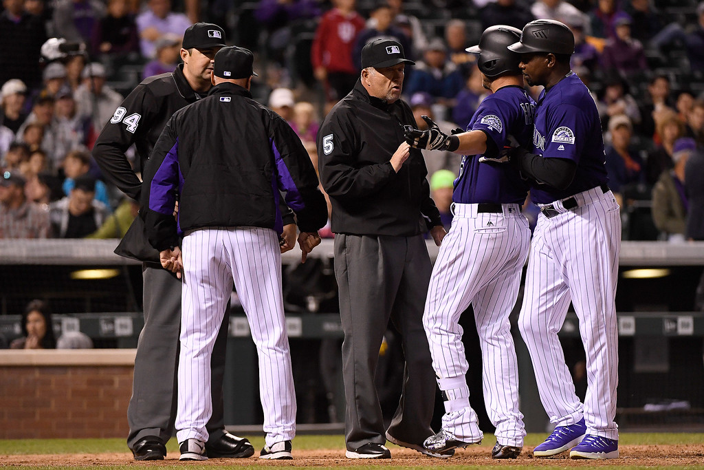 . DENVER, CO - APRIL 25: Ryan Raburn (6) of the Colorado Rockies and acting manager Tom Runnels argue balls and strikes with the umpiring crew as third base coach Stu Cole holds Raburn back during the inning at Coors Field. The Colorado Rockies hosted the Pittsburgh Pirates on Monday, April 25, 2016. (Photo by AAron Ontiveroz/The Denver Post)