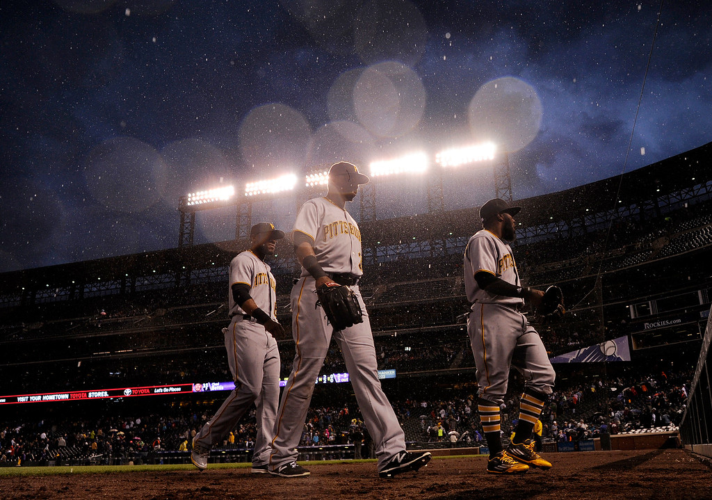 . DENVER, CO - APRIL 25: From right Josh Harrison (5) of the Pittsburgh Pirates, Gregory Polanco (25) and Starling Marte (6) walk off the field during during a rain delay while playing the Colorado Rockies at Coors Field. The Colorado Rockies hosted the Pittsburgh Pirates on Monday, April 25, 2016. (Photo by AAron Ontiveroz/The Denver Post)