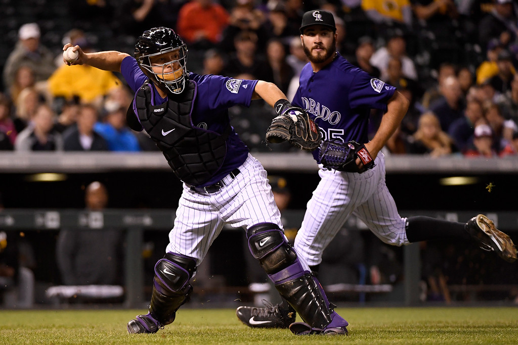 . DENVER, CO - APRIL 25: Nick Hundley (4) of the Colorado Rockies throws out Jeff Locke (49) of the Pittsburgh Pirates on a bunt attempt during the fifth inning at Coors Field. The Colorado Rockies hosted the Pittsburgh Pirates on Monday, April 25, 2016. (Photo by AAron Ontiveroz/The Denver Post)