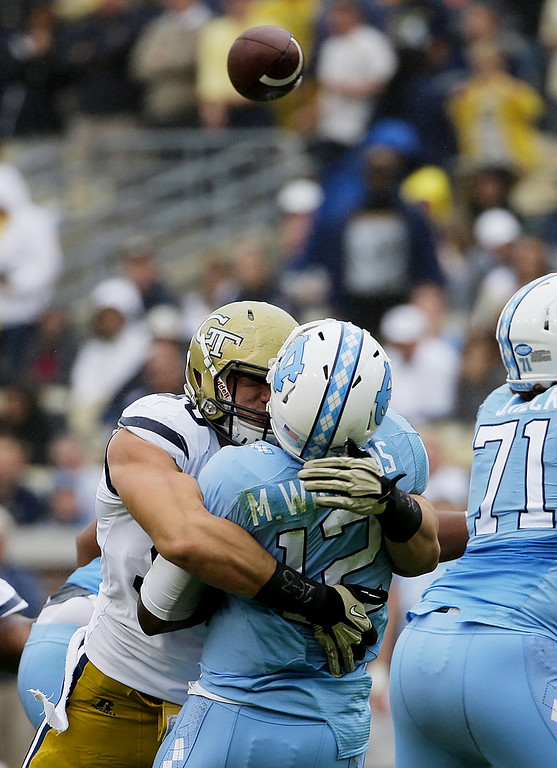 . Georgia Tech defensive lineman Adam Gotsis, left, sacks North Carolina quarterback Marquise Williams in the second quarter of an NCAA college football game Saturday, Oct. 3, 2015, in Atlanta. Gotsis was ejected from the game for the hit. (AP Photo/David Goldman)