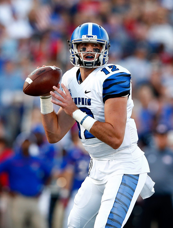. LAWRENCE, KS - SEPTEMBER 12:  Quarterback Paxton Lynch #12 of the Memphis Tigers passes during the game against the Kansas Jayhawks at Memorial Stadium on September 12, 2015 in Lawrence, Kansas.  (Photo by Jamie Squire/Getty Images)