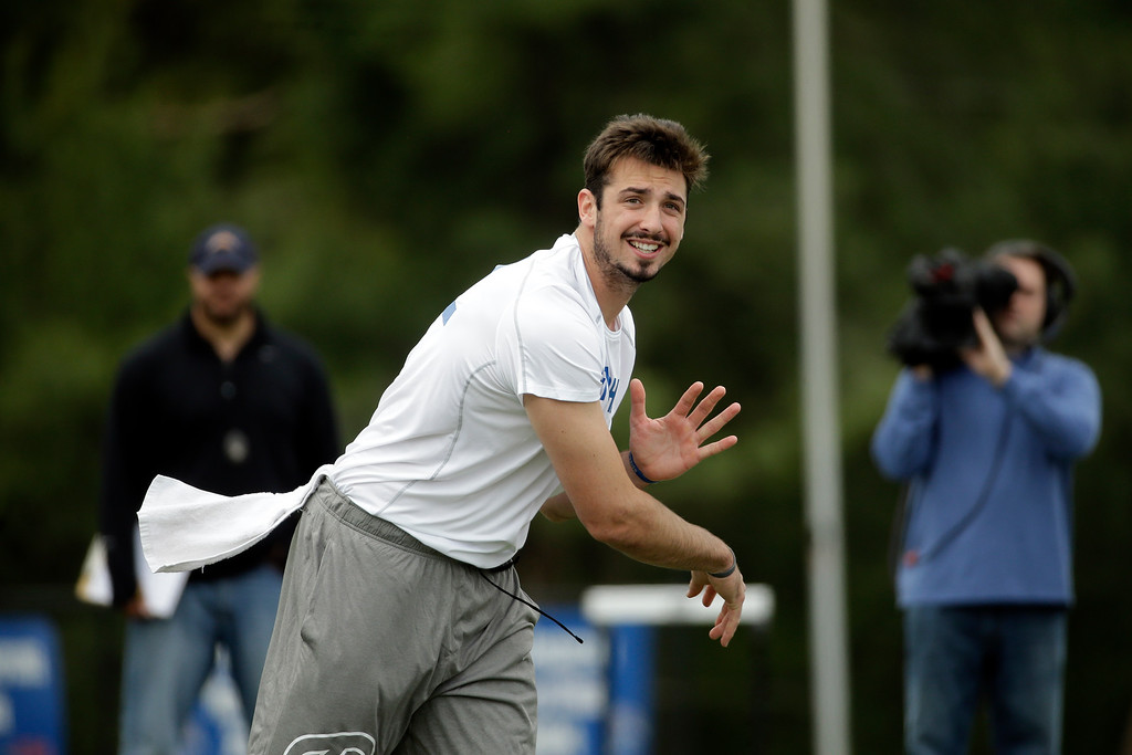 . FILE - In this April 6, 2016 file photo, Memphis quarterback Paxton Lynch passes during the school\'s NFL football pro day, in Memphis, Tenn. A note from a Memphis administrator led Justin Fuente to a quarterback in Florida who taught himself how to throw a football by tossing a baseball. Now Paxton Lynch is poised to become the highest quarterback ever drafted from a university best known for its basketball program.  (AP Photo/Mark Humphrey, File)