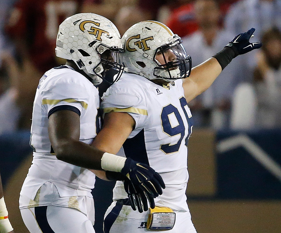 . Georgia Tech defensive lineman Adam Gotsis (96) reacts to tackling Florida State wide receiver Da\'Vante Phillips (5) during the first half of an NCAA college football game, Saturday, Oct. 24, 2015, in Atlanta. (AP Photo/Mike Stewart)