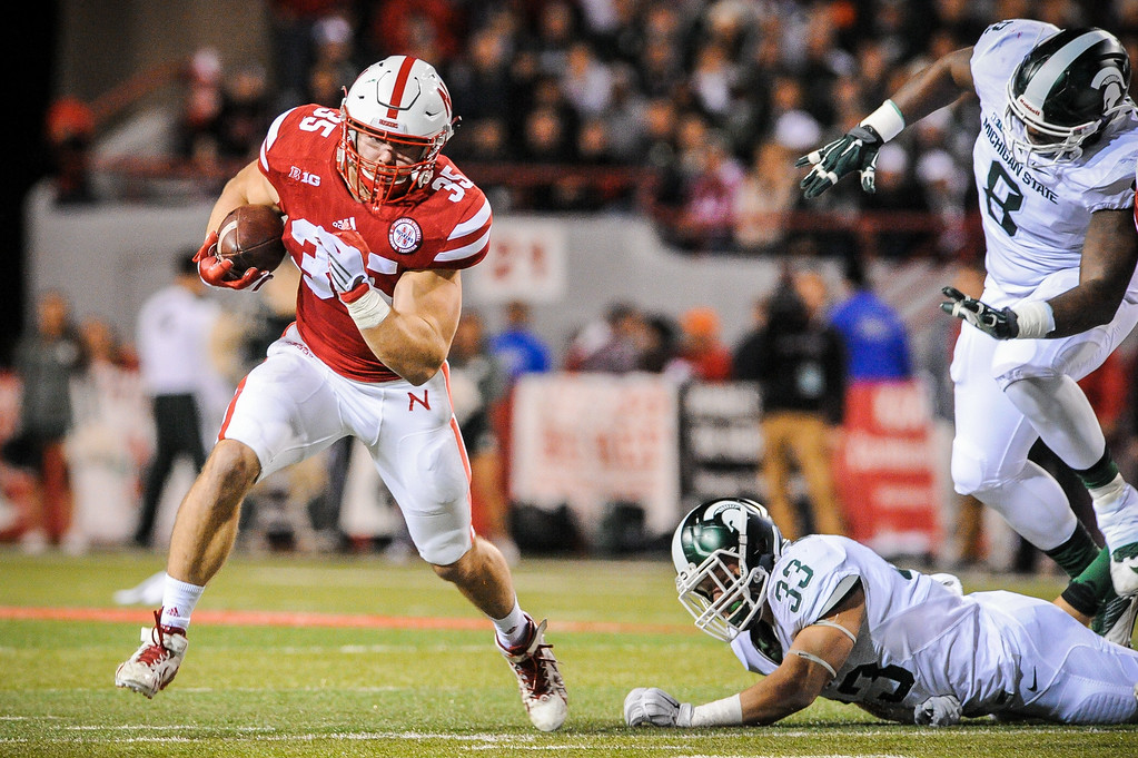 . Fullback Andy Janovich #35 of the Nebraska Cornhuskers runs past linebacker Jon Reschke #33 of the Michigan State Spartans during their game at Memorial Stadium on November 7, 2015 in Lincoln, Nebraska. (Photo by Eric Francis/Getty Images)