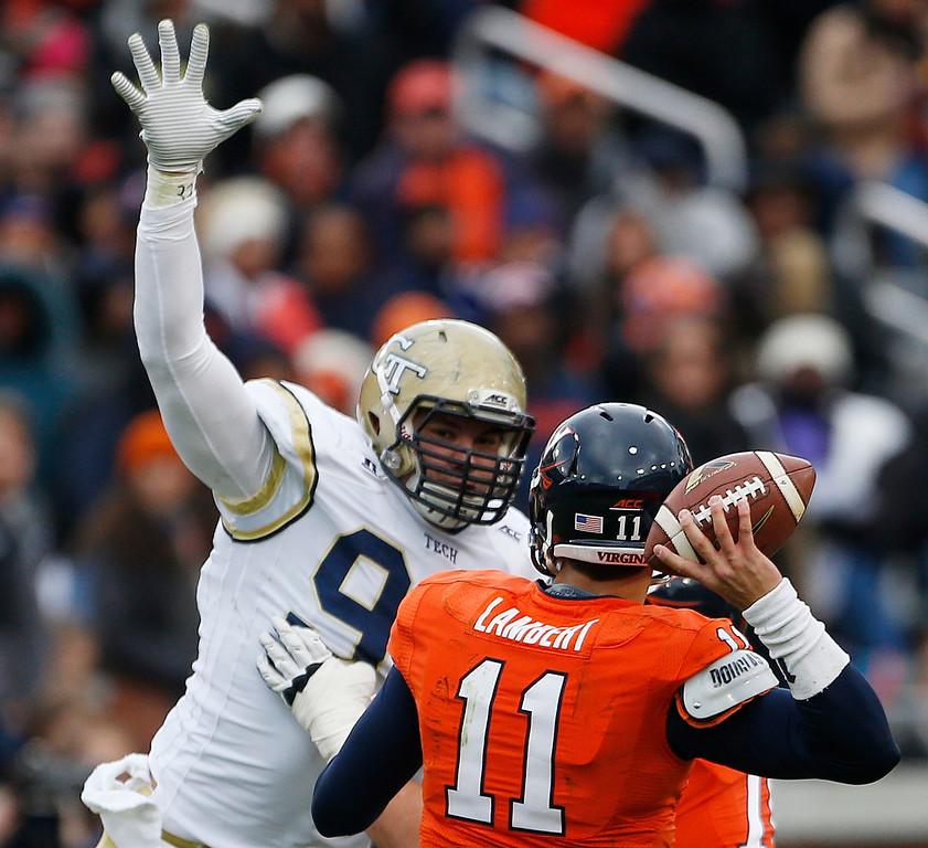 . Georgia Tech defensive lineman Adam Gotsis (96) defends against Virginia quarterback Greyson Lambert during the first half of an NCAA college football game, Saturday, Nov. 1, 2014, in Atlanta. (AP Photo/Mike Stewart)