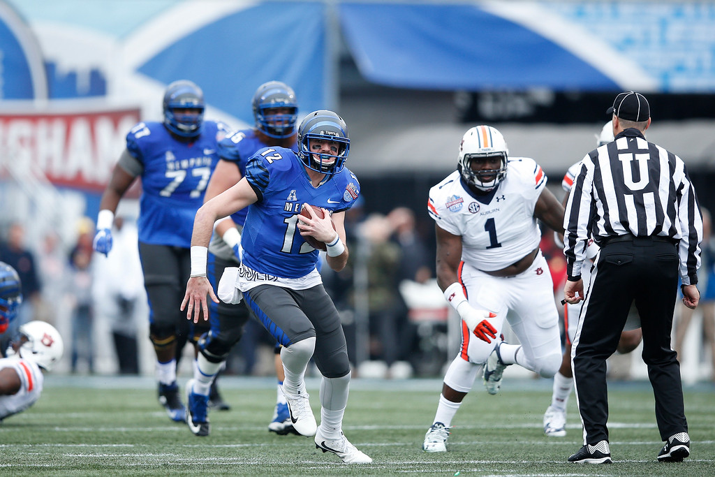 . BIRMINGHAM, AL - DECEMBER 30: Paxton Lynch #12 of the Memphis Tigers runs with the ball against the Auburn Tigers in the first half of the Birmingham Bowl at Legion Field on December 30, 2015 in Birmingham, Alabama. (Photo by Joe Robbins/Getty Images)