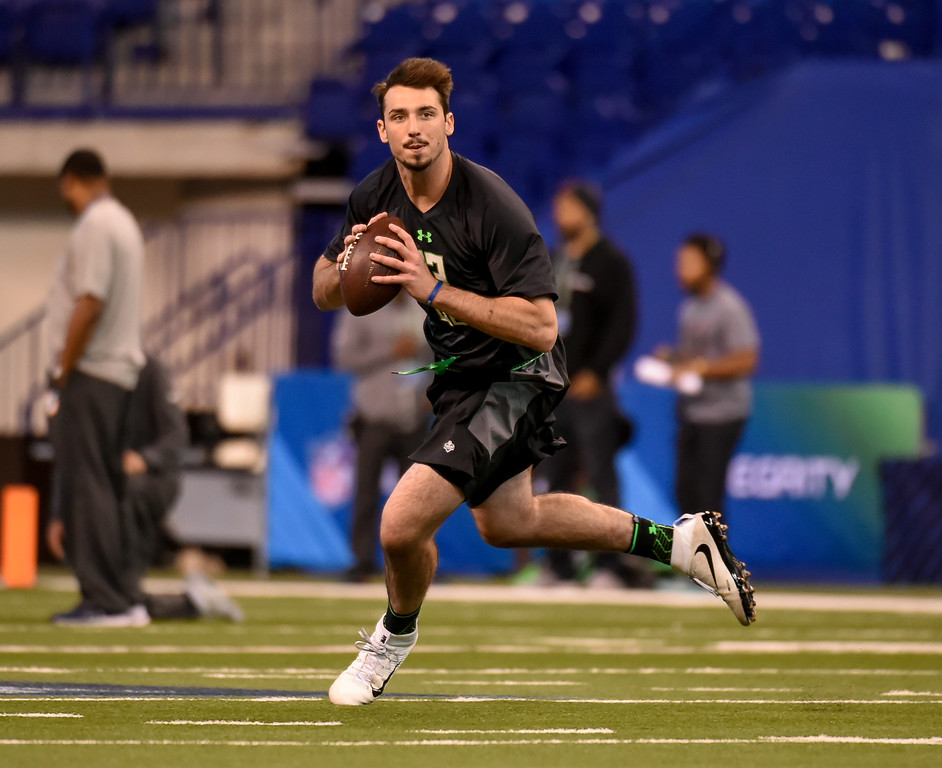 . FILE - In this Feb. 27, 2016 file photo, Memphis quarterback Paxton Lynch runs a drill at the NFL football scouting combine, in Indianapolis. The facts about Braxton Miller\'s potential NFL career are clear: a transition from star quarterback at Ohio State to maybe wide receiver as a pro.  He\'s sharing the journey with fans through a 360-degree virtual reality video. Not to be outdone, Paxton Lynch _ who will be playing quarterback in the NFL and quite possibly will be a first-round pick in Thursday night\'s draft _ is taking the same VR route. (AP Photo/L.G. Patterson, File)