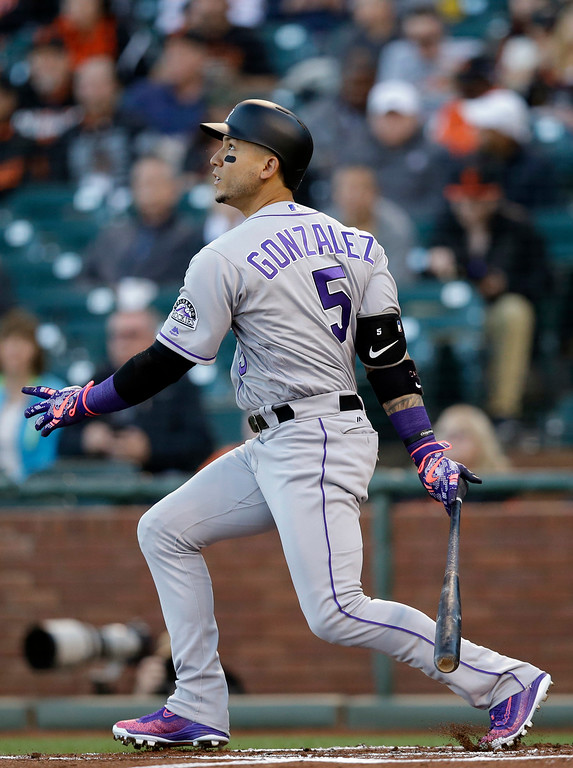 . Colorado Rockies\' Carlos Gonzalez singles during the first inning of a baseball game against the San Francisco Giants Thursday, May 5, 2016, in San Francisco. (AP Photo/Marcio Jose Sanchez)