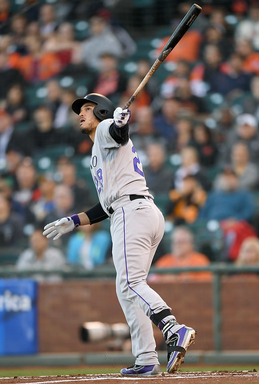 . SAN FRANCISCO, CA - MAY 05:  Nolan Arenado #28 of the Colorado Rockies swings and watches the flight of his ball as he hits a two-run home run against the San Francisco Giants in the top of the first inning at AT&T Park on May 5, 2016 in San Francisco, California.  (Photo by Thearon W. Henderson/Getty Images)