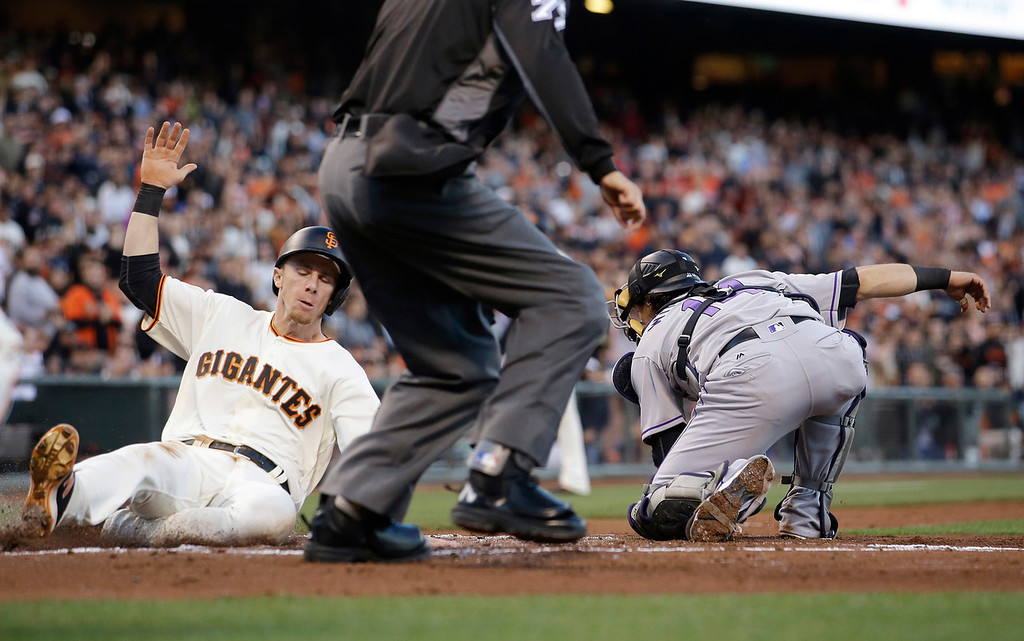 . San Francisco Giants\' Matt Duffy, left, scores past the tag attempt from Colorado Rockies catcher Tony Wolters on a double from Buster Posey during the first inning of a baseball game Thursday, May 5, 2016, in San Francisco. (AP Photo/Marcio Jose Sanchez)